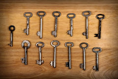 Old Keys Set. On the Wooden Background Royalty Free Stock Image