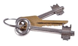 Old keys on a white Stock Images