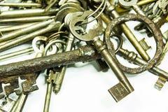 Old keys on white. Background stock photography