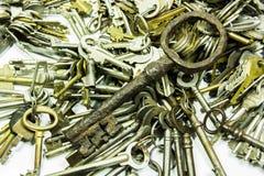 Old keys on white. Background royalty free stock photos