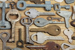 Old keys on wood. Old different keys on wooden background Royalty Free Stock Photo