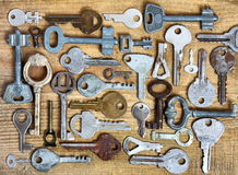 Old keys on wooden background. Old different keys on wooden background Royalty Free Stock Photo