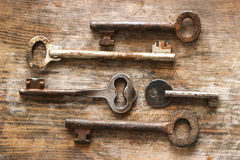 Old keys on wooden background Royalty Free Stock Photography