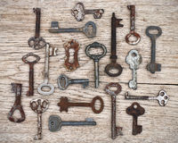 Old keys on wooden background Stock Images