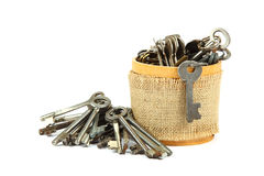 Old keys in a wooden morta. Royalty Free Stock Images