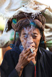 Old Khmer woman smoking cheerot cigarette in Myanm Stock Image