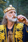 Old king drinking from the goblet Stock Photography