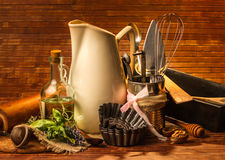 Old kitchen cooking utensil. On wooden background Royalty Free Stock Photo