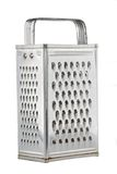 Old kitchen grater. Old-fashioned universal steel kitchen grater Royalty Free Stock Image
