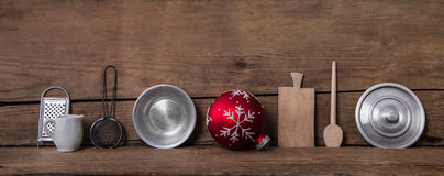 Old kitchen miniatures on wooden background for christmas decora Royalty Free Stock Images
