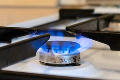 Old kitchen stove cook with blue flames burning. Can be a source of fire or explosion. Household gas stove. In kitchen room royalty free stock photos