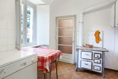 Old kitchen with stove in normal interior Royalty Free Stock Photo
