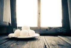 Old kitchen table rural hut morning egg Stock Images
