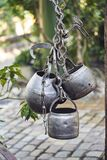 Old kitchen tools hanging outdoors.  royalty free stock photo