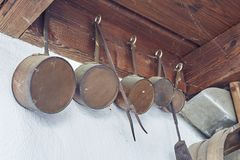 Old kitchen tools in a wall. Old kitchen tools on the wall stock photo