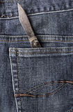 Old knife back pocket jeans Royalty Free Stock Photos