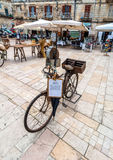 Old knife grinder bicycle and main square in Ostuni, Italy Stock Photos