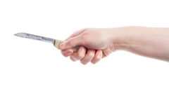 Old knife in hand Stock Images