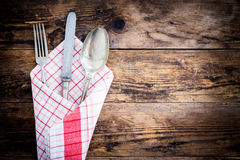 Old knife, spoon and fork decoratively presented. Royalty Free Stock Photography