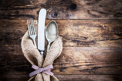 Old knife, spoon and fork decoratively presented. Royalty Free Stock Photos