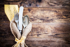 Old knife, spoon and fork decoratively presented. Royalty Free Stock Image