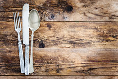 Old knife, spoon and fork decoratively presented. Royalty Free Stock Photo