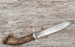 Old knife on the weathered wood Royalty Free Stock Images