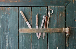 Old knifes plugged in a wooden door Stock Photos