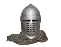 Old knight's helmet and chainmail. Old knight helmet and chain mail for protection in battle. is made of metal. of knightly armor Royalty Free Stock Photography