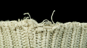 Old knit sweater background. Beige color. Studio shot Stock Photos