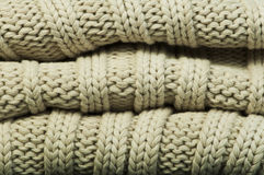 Old knit sweater background. Beige color. Studio shot Stock Photo