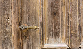 Old knob on vintage wooden door Royalty Free Stock Photo
