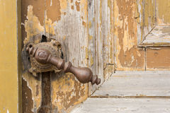 Old knob on vintage wooden door Royalty Free Stock Images