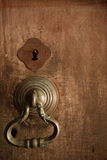 Old knob on wooden door. Old brass knob on traditional wood door at entrance to buddhist monastery Stock Images