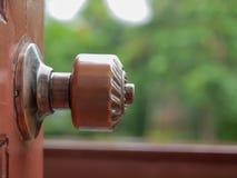 Old knob of a wooden door. Old knob of a wooden door Interior Design Stock Photo