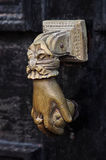Old knocker. Old brass, English knocker in the shape of a hand Royalty Free Stock Photos