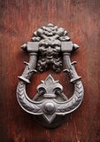 Old knocker on a door Stock Photos