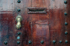Old knocker. In the shape of a hand on a door of a traditional Moroccan house Royalty Free Stock Photos