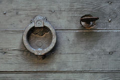 Old Knocker. On a wooden door Royalty Free Stock Photography