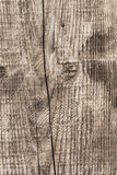 Old Knotted Cracked Rough Textured Plank - Detail. Photograph of an old, obsolete, weathered, stained, hammered plank, with large wood knot and lateral cracks Stock Photo