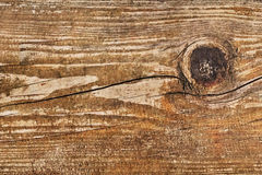 Old Knotted Rotten Cracked Painted Peeled-Off Plank - Detail. Photograph of an old, knotted, rotten, cracked, painted, peeled-off plank - knot detail Royalty Free Stock Image