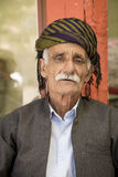 Old Kurdish man. Portrait of Kurdish old man wearing kurdish custome and hat in Sualimanya city in Iraq Stock Photo