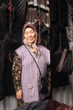Old kyrgyz woman selling clothes Stock Photography