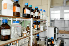 Old laboratory with a lot of bottles Stock Photos