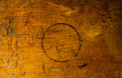 Old lacquer plywood texture. Side of old used wooden toolbox with round burn in center Royalty Free Stock Photo