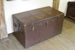Old lacquered chest with lock, slightly damaged.  with clipping path Royalty Free Stock Photos