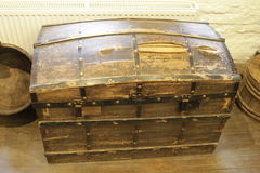 Old lacquered chest with lock, slightly damaged.  with clipping path Royalty Free Stock Photography