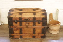 Old lacquered chest with lock, slightly damaged.  with clipping path Royalty Free Stock Image