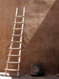 Old Ladder. Vintage southwestern ladder against an adobe wall Stock Images