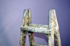 Old ladder to paint. Old Wood Ladder covered in paint royalty free stock image